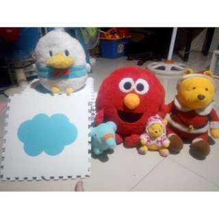 Assorted Stuffed toys and placemat