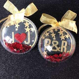 Shaker ornament in black , gold red
