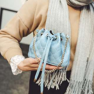 Mini quilted baby blue bucket sling bag