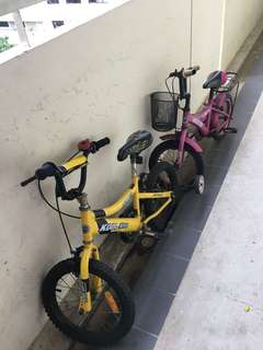 Two bikes, pink n yellow