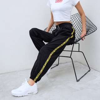 RING ZIPPER HAREM PANTS WITH SIDE TAPE