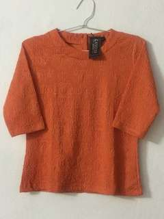 Kaos Orange motif timbul
