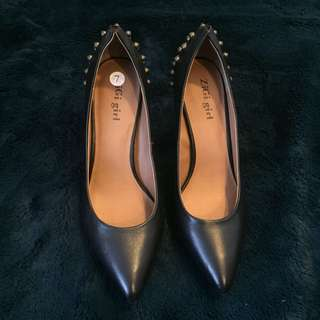 Black shoes, never worn.