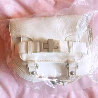 White Sling Bag Brand new in plastic - very sweet and pretty
