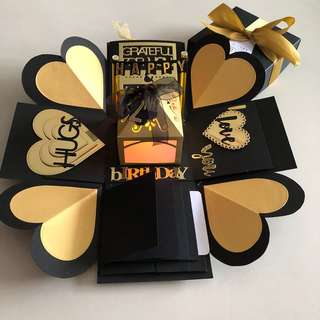Explosion box with lighthouse.  4 waterfall in black and gold