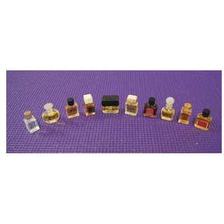 Ten Miniature Perfume bottles with Perfume in them for a total price of $8
