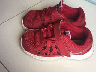 Red authentic Nike shoes