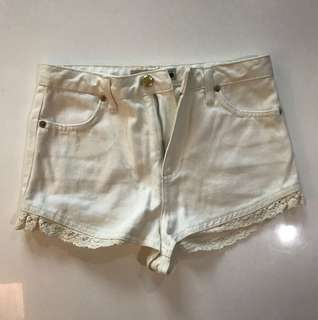 Topshop Moto denim shorts in off white with lace details