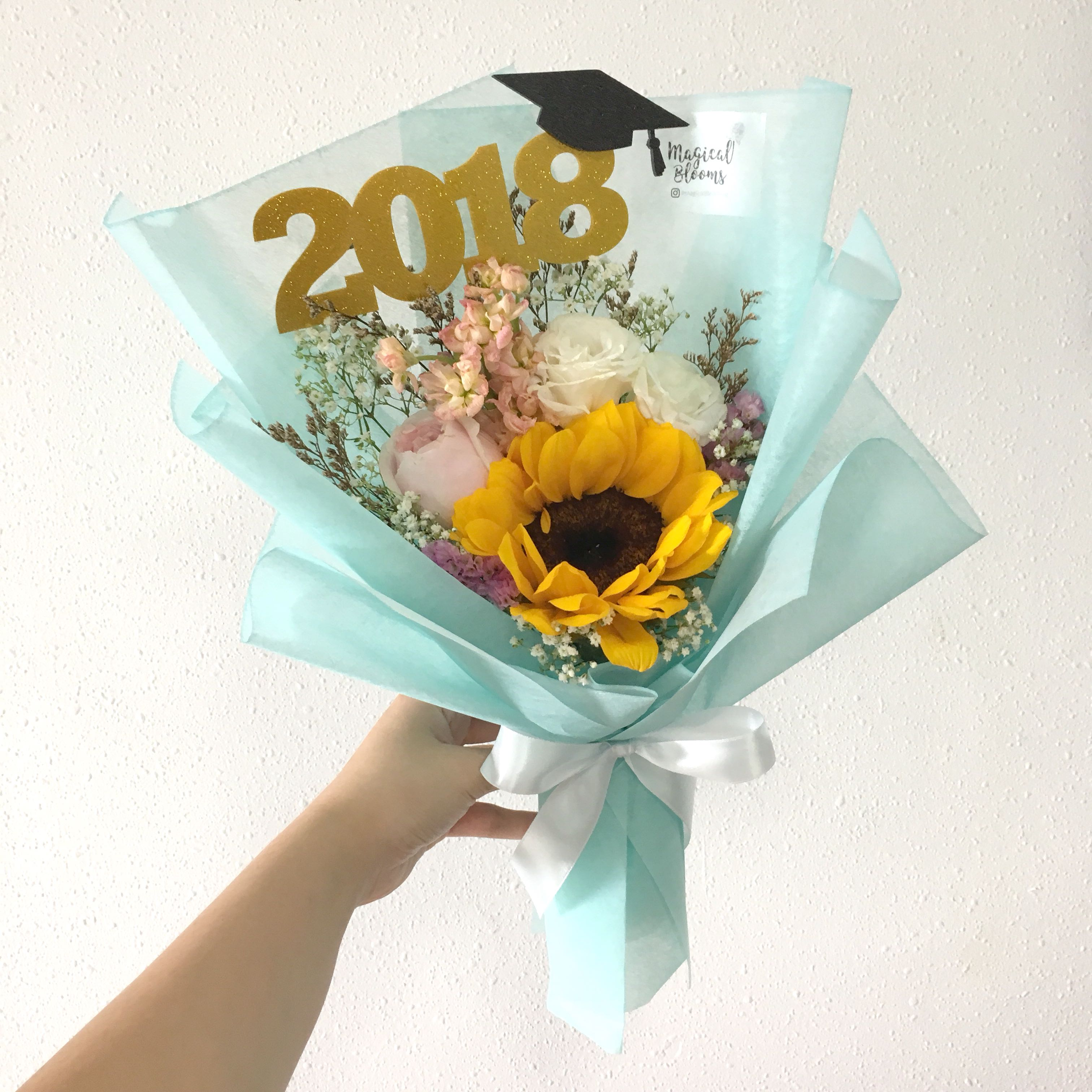 Graduation flower bouquet in sunflowers and mix fillers with baby photo photo photo izmirmasajfo