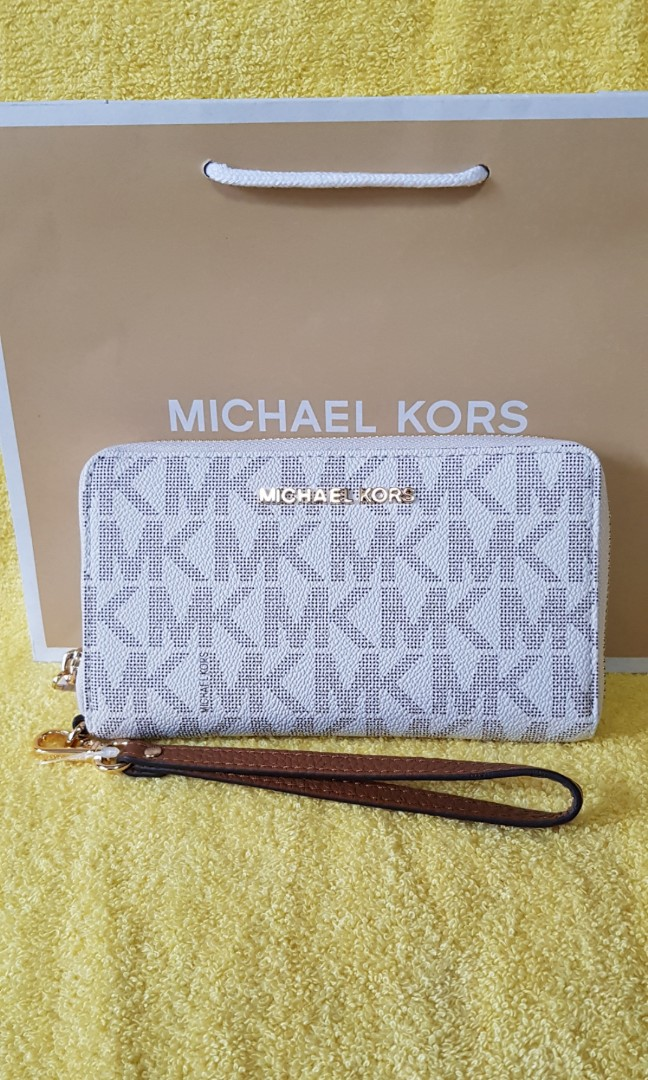 c7b9ffc08d4b MK wallet / phone wristlet, Luxury, Bags & Wallets on Carousell