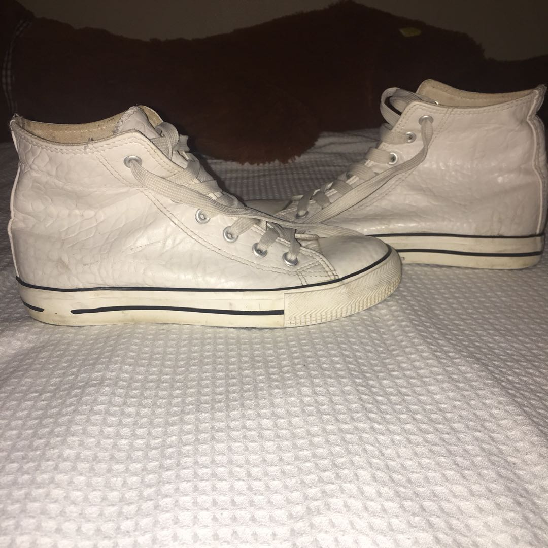 White leather high tops