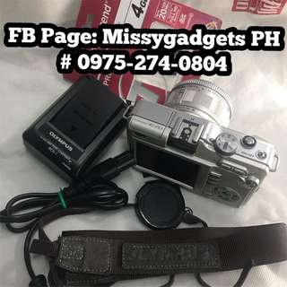 Olympus E-PL1 mirrorless 12mp with 14-42mm kit and accessories