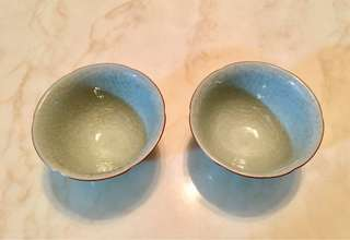 A pair of handmade turquoise colour glaze ceramic cups