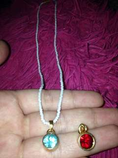 Antique pearl necklace with two coloured gems