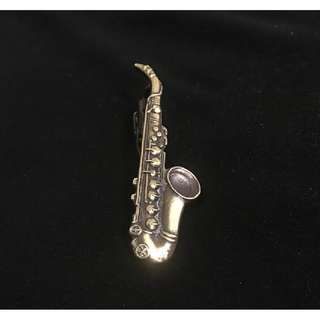 Mint  vintage saxaphone tie mint clip selling at a low price.