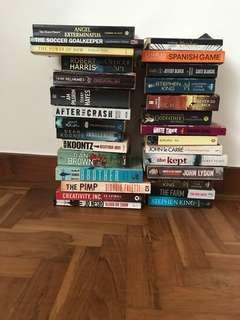 Various paperback books