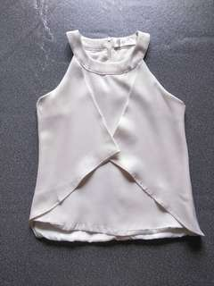 Sleeveless white casual/formal blouse