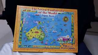 Thick book with many world map puzzle