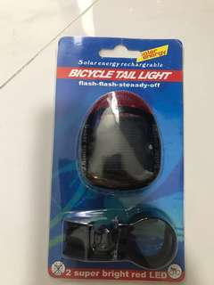 Solar energy rechargeable bicycle tail light