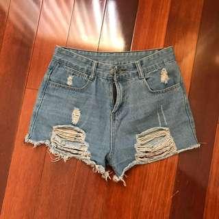 Ripped high waisted denim shorts