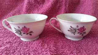 A pair of handpainted vintage cups