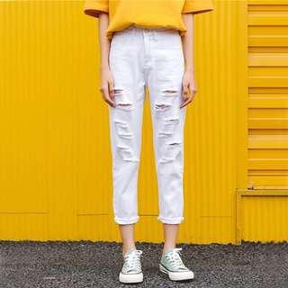 白色刷破九分牛仔褲