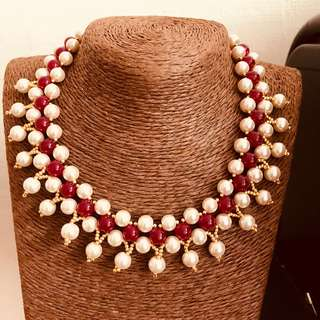 Ruby with white pearl necklace