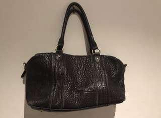 Status anxiety real leather bag
