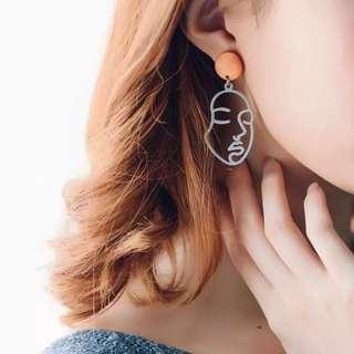 BN Face earrings