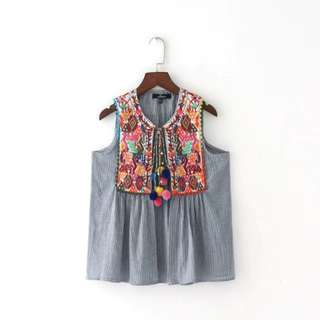 Grey and White Sleeveless with Colourful embroidery with tassels