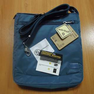AUTHENTIC Pacsafe Luggage bag Citysafe 175 anti theft shoulder sling crossbody bag blue