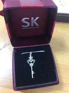 SK Key Pendant