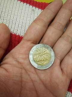 Uang lama seribu rupiah kelapa sawit