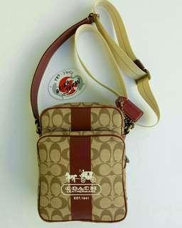 Coach Monogram Sling Bag