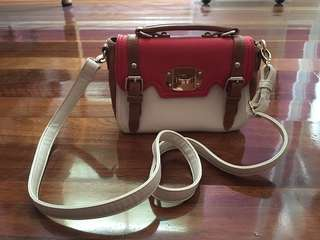 Red and white satchel bag