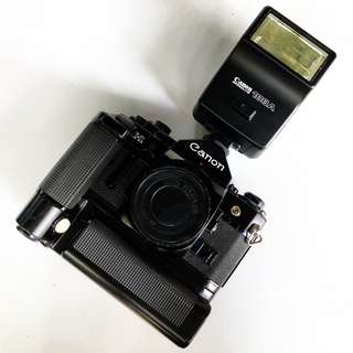 Canon A-1 w/ motor drive battery pack speedlite