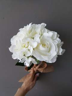 White artificial bouquet with burlap ribbon