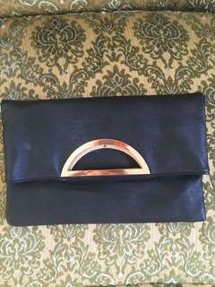 Black clutch with gold hardware