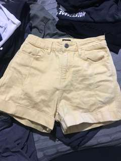 Yellow Lee high waisted shorts