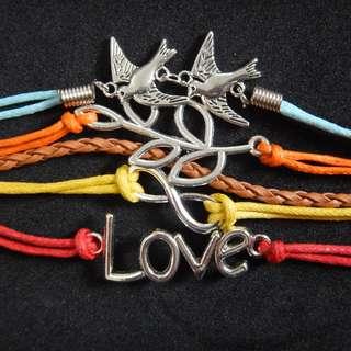 Dove, fern, love, and infinity bracelet
