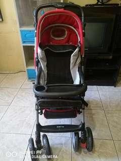 Baby 1st red stroller