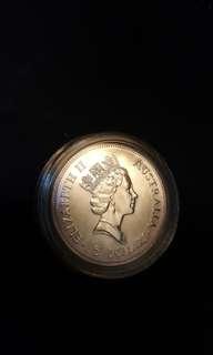 1990 $5 Australian Kookaburra silver coin.