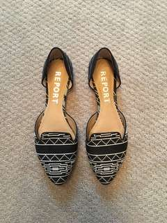 Report black and white slip on shoes. Size 8.