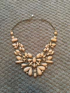 Aldo light pink and gold statement necklace