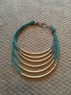 Faux teal leather and gold metal statement necklace