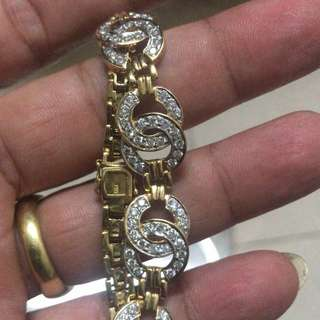 18k gold with diamond cluster Chanel bracelet