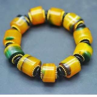 Natural Fine Grade Yellow Jade Green Agate 11 bead Magic power Elastic Bracelet Estimated Retail is $300