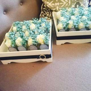 rampai with white roses & baby blue sprays