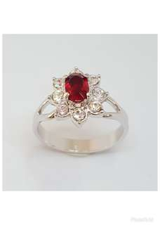 Rhodium plated Ring with Ruby & clear crystals.