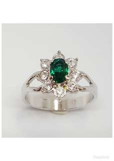 Rhodium plated Ring with Emerald & clear crystals.